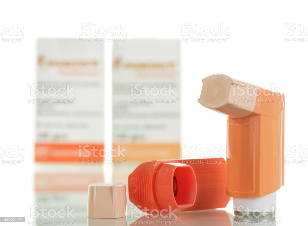 Device for inhalation with a dispenser isolated Device for inhalation with a dispenser isolated on white background Aerosol Can Stock Photo
