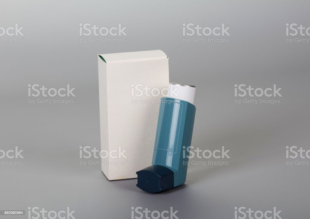 Device for inhalation with a dispenser on gray stock photo