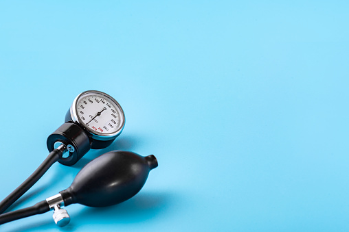 istock Device for measuring blood pressure. Tonometer, cuff, stethoscope on a blue background. Copy-space 1219818856