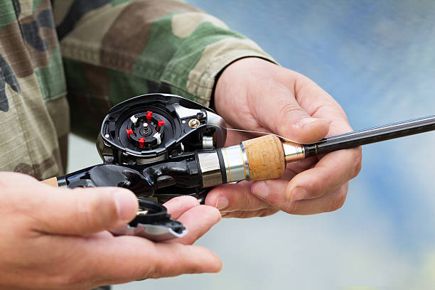 Device the multiplier fishing reel stock photo