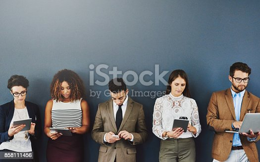 858111468 istock photo Devices that keep the boredom away 858111456