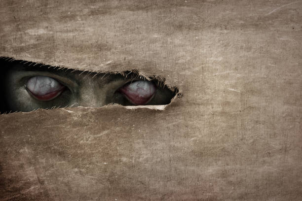 devil eyes peeking - horror stock pictures, royalty-free photos & images