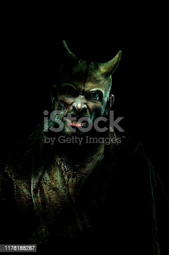 Devil on dark background