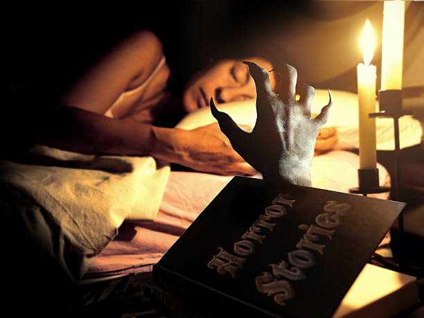 devil vampire hand grabbing sleeping woman - graf dracula stock-fotos und bilder