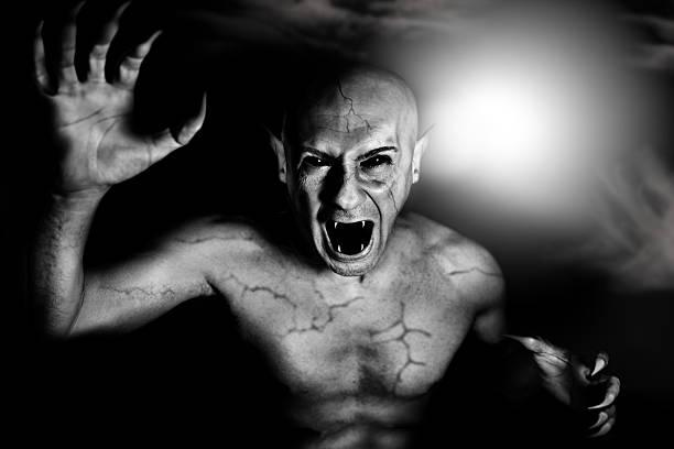 devil vampire on halloween - graf dracula stock-fotos und bilder