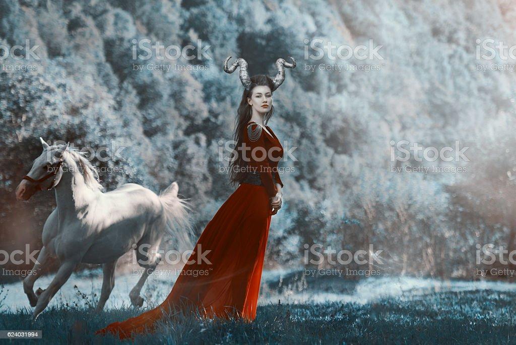 devil woman in nature stock photo