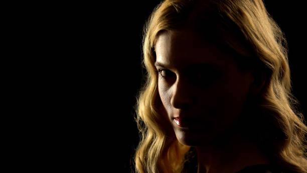 devil woman looking at camera, black background, paranormal mystery, white eyes - seitas imagens e fotografias de stock