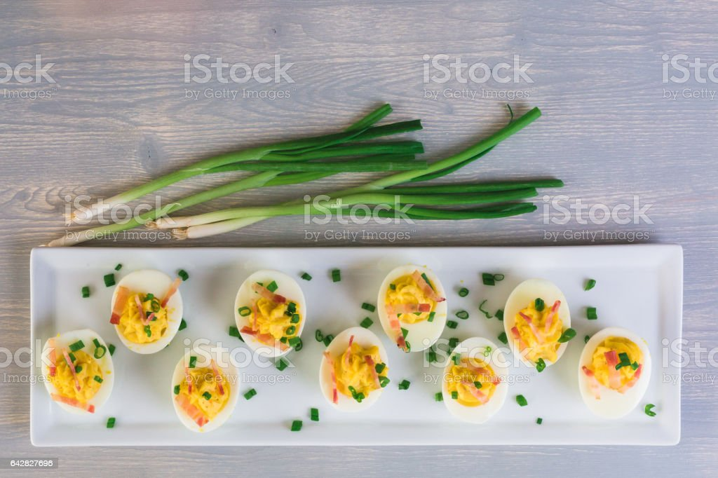 Deviled eggs garnished stock photo
