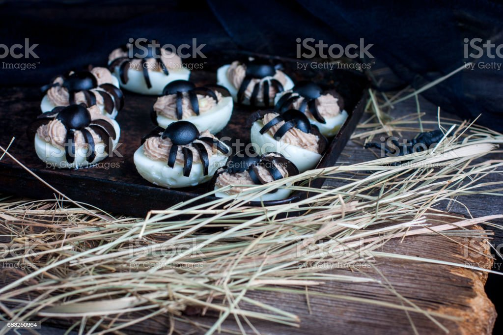 Deviled eggs with a Spider for Halloween royalty-free stock photo