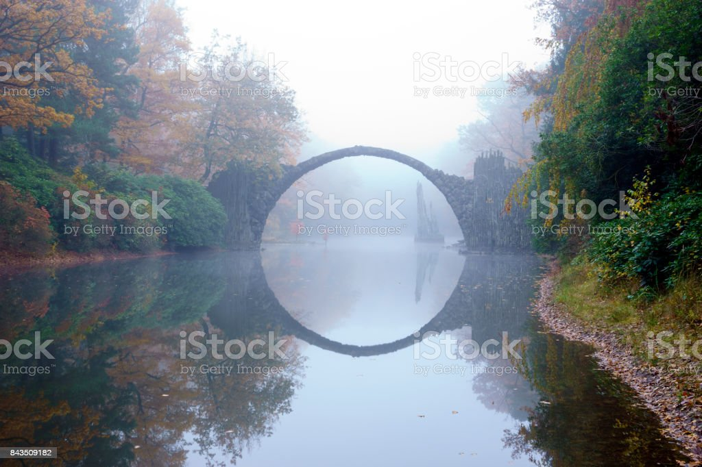 Devil's bridge in Kromlau in autumn coat stock photo