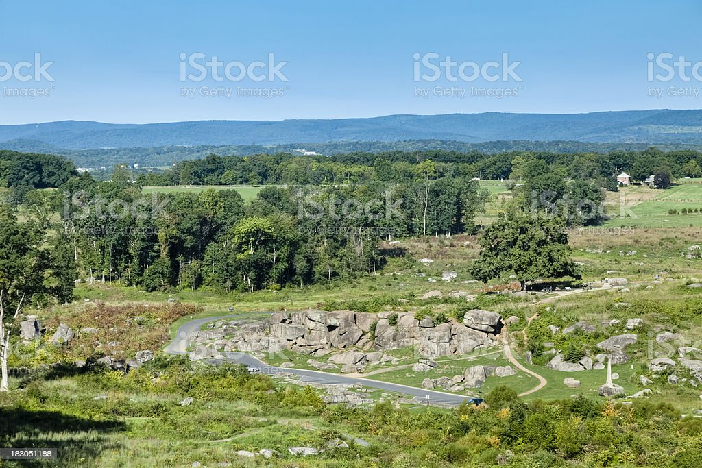 Devils Den at Gettysburg Battlefield with Rolling Hills and Mountains royalty-free stock photo