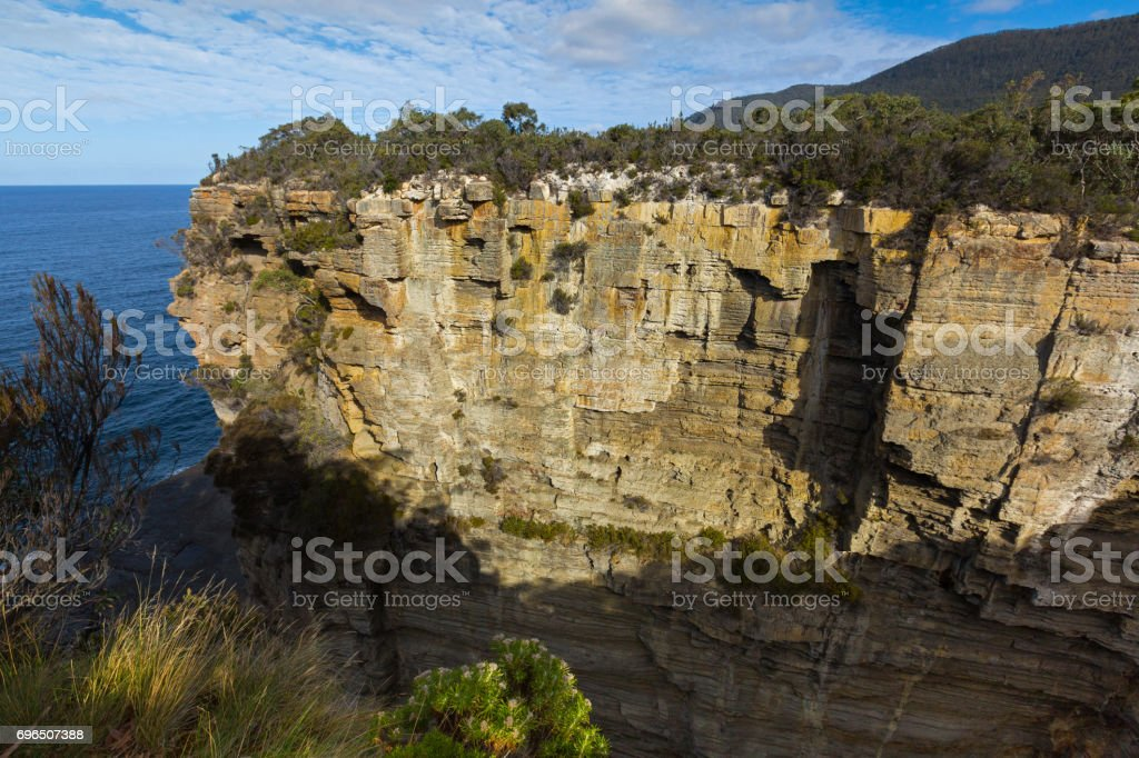 Devil's Kitchen, former sea cave now deep narrow gulch torn by the waves wind over millions of years, Tasmania, Australia. stock photo