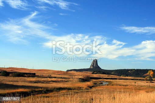 Devils Tower Big Sky View with stream in the foreground in Wyoming USA