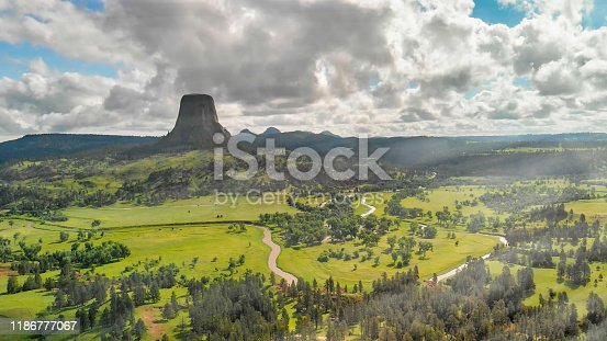 Devil's Tower National Monument and surrounding landscape in summer season. Beautiful aerial view on a sunny afternoon.