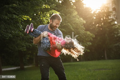istock Devoted father spinning his daughter in circles 541153830