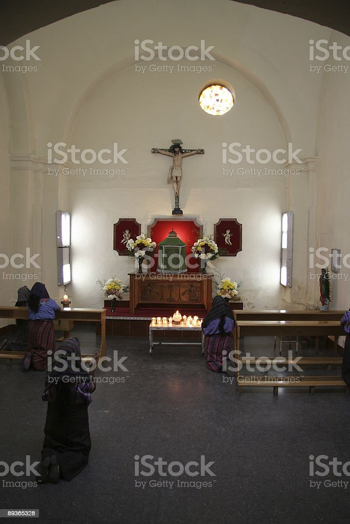 devoted people praying to Jesus Christ royalty-free stock photo