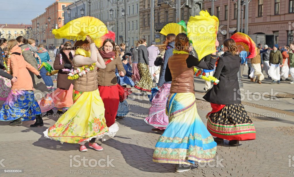 Devotees of the Lord Krishna dance and sing. stock photo