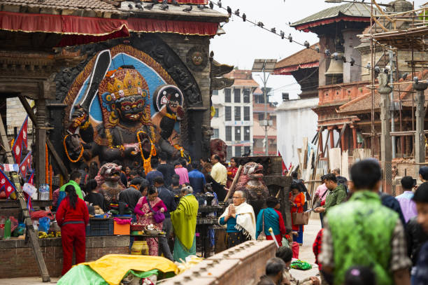 Devotees worshiping Kal Bhairav in Kathmandu Durbar Square during the the Nepalese New Year 2073 Festival. stock photo