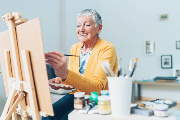 Devoting enough time to my favorite hobby Senior artist woman drawing at home hobbies stock pictures, royalty-free photos & images
