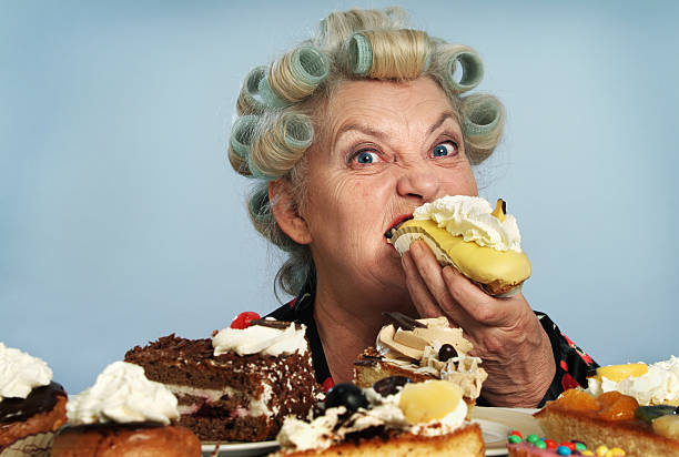 devouring 01 - funny fat lady stock photos and pictures