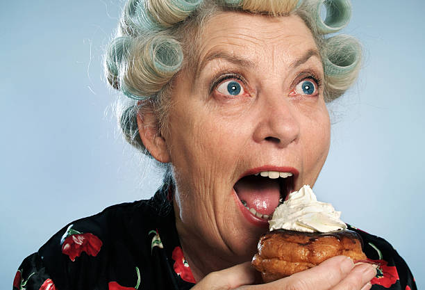 devouring 02 - funny fat lady stock photos and pictures