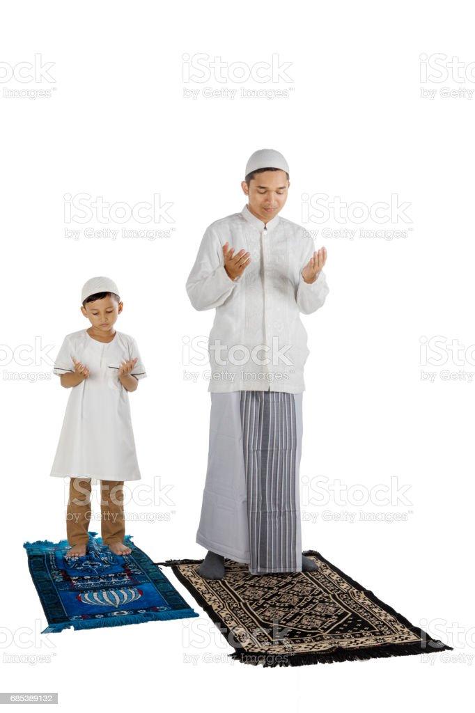 Devout family prays to the Allah royalty-free stock photo