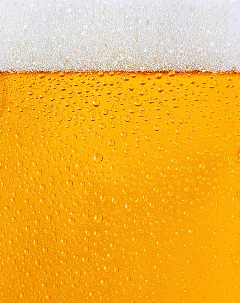 Dewy beer glass bottle texture stock photo