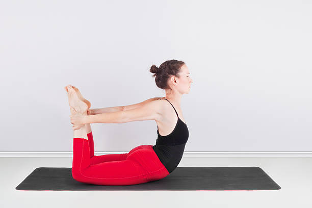 Dhanurasana - The Bow stock photo