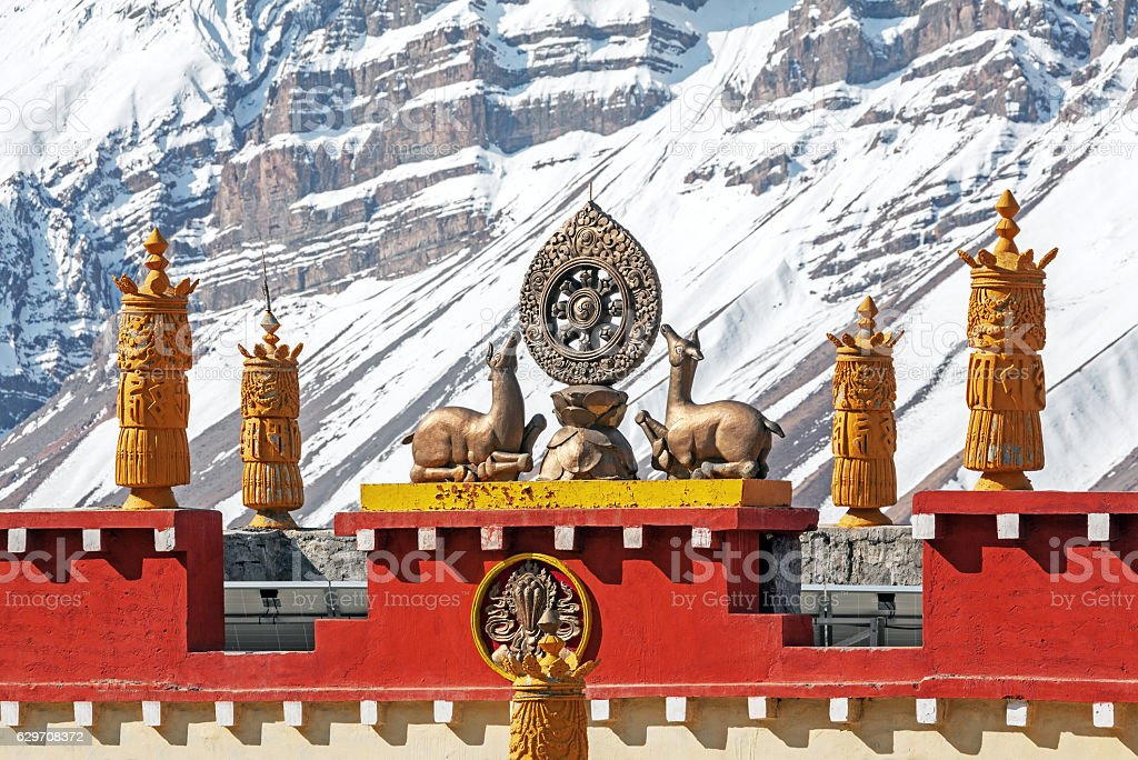 Dharma Wheel Tibetan Buddhist Temple Background Snowy Mountains stock photo