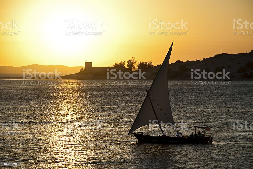 "Dhow at Sunset ""A dhow sailboat at sunset off the coast of Lamu, Kenya"" African Culture Stock Photo"