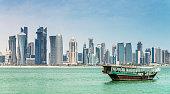 Dhow cruising to modern Skyline of Doha, Qatar