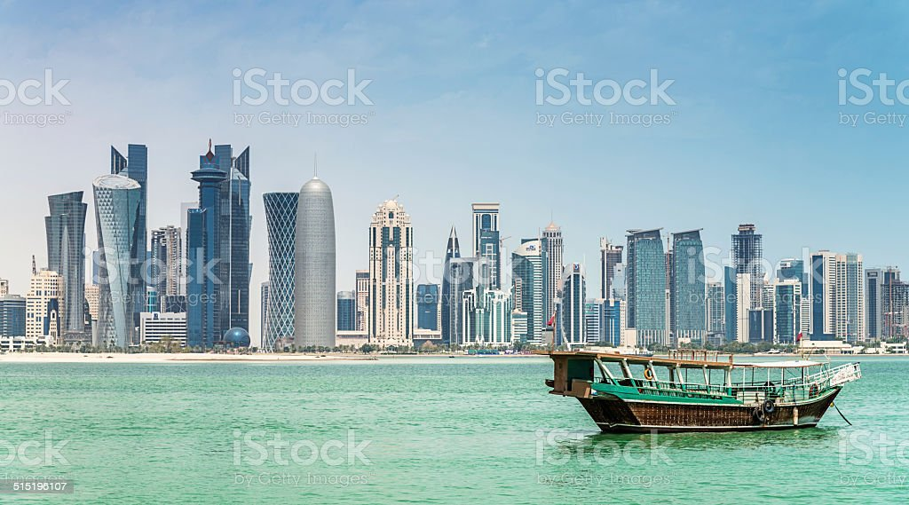 Dhow cruising to modern Skyline of Doha, Qatar stock photo