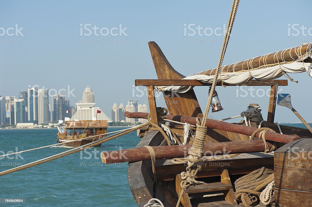 Dhows in the harbor of Doha, Qatar on clear day royalty-free stock photo
