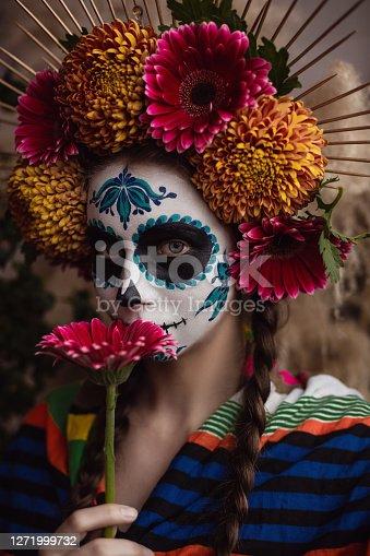 Young woman wearing La Calavera Catrina make-up.