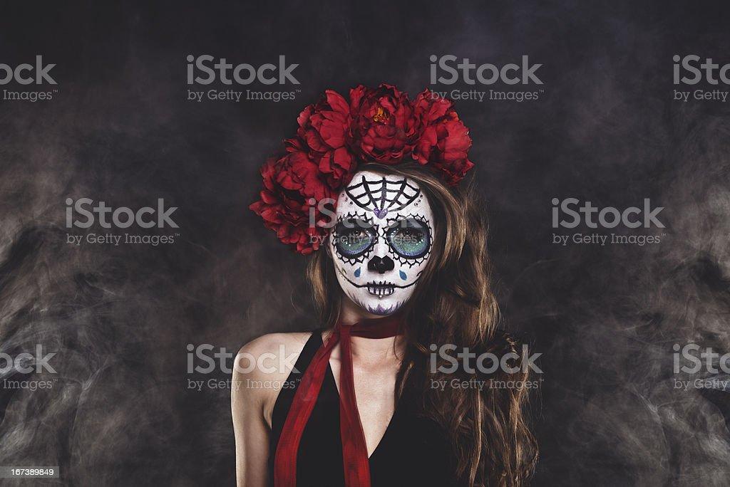 Dia De Los Muertos Sugar skull woman surrounded by smoke stock photo