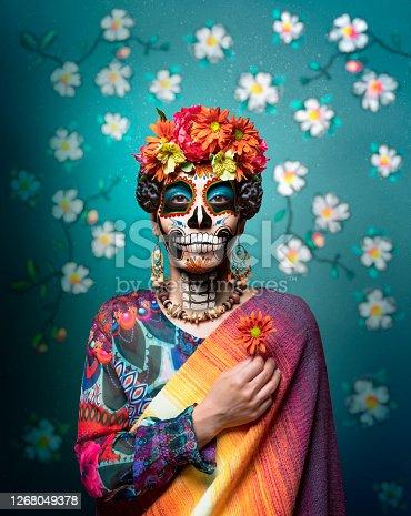 istock Dia de los Muertos woman with ceremonial make-up 1268049378