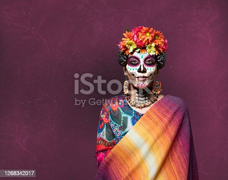 Woman with ceremonial make-up also known as Sugar skull, used in traditional Mexican Dia de los Muertos celebration.