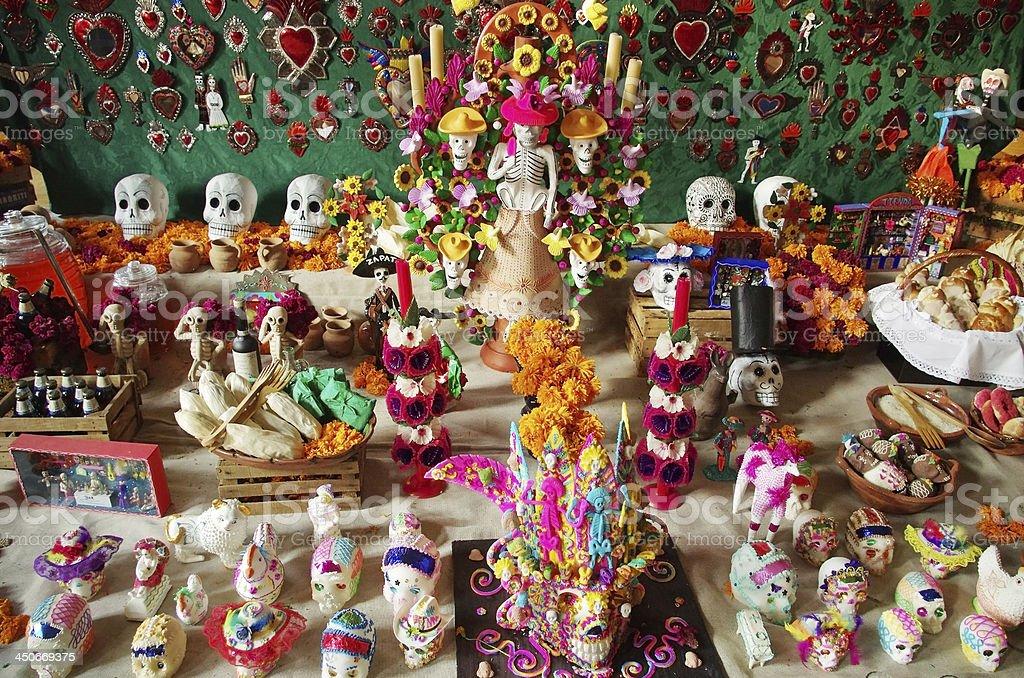 Dia de Muertos table sugar skulls stock photo