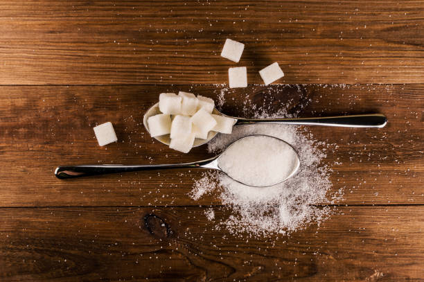 Diabetes. A lot of sugar cubes in spoon. Top view