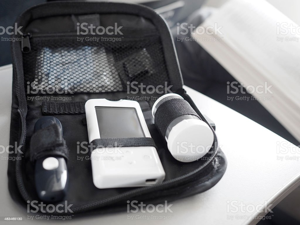 Diabetes blood glucose testing kit on a airplane. stock photo