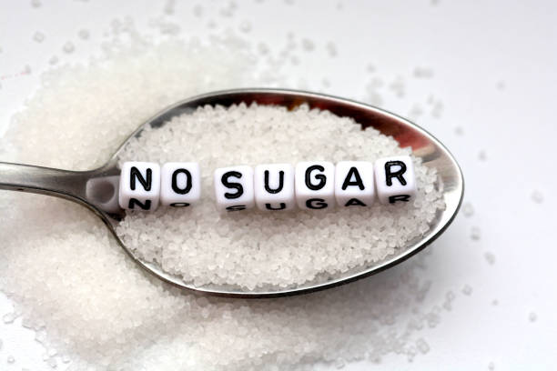 diabetes concept suggesting no sugar consumption - zuckerfreie lebensmittel stock-fotos und bilder