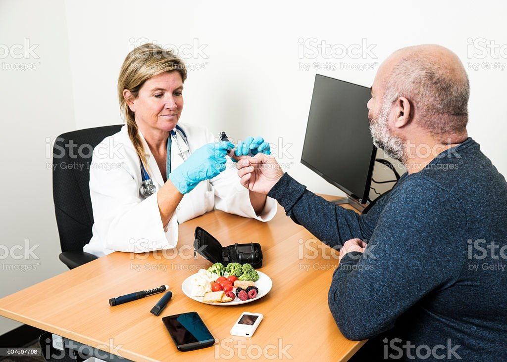 Diabetes healthcare specialist with patient stock photo