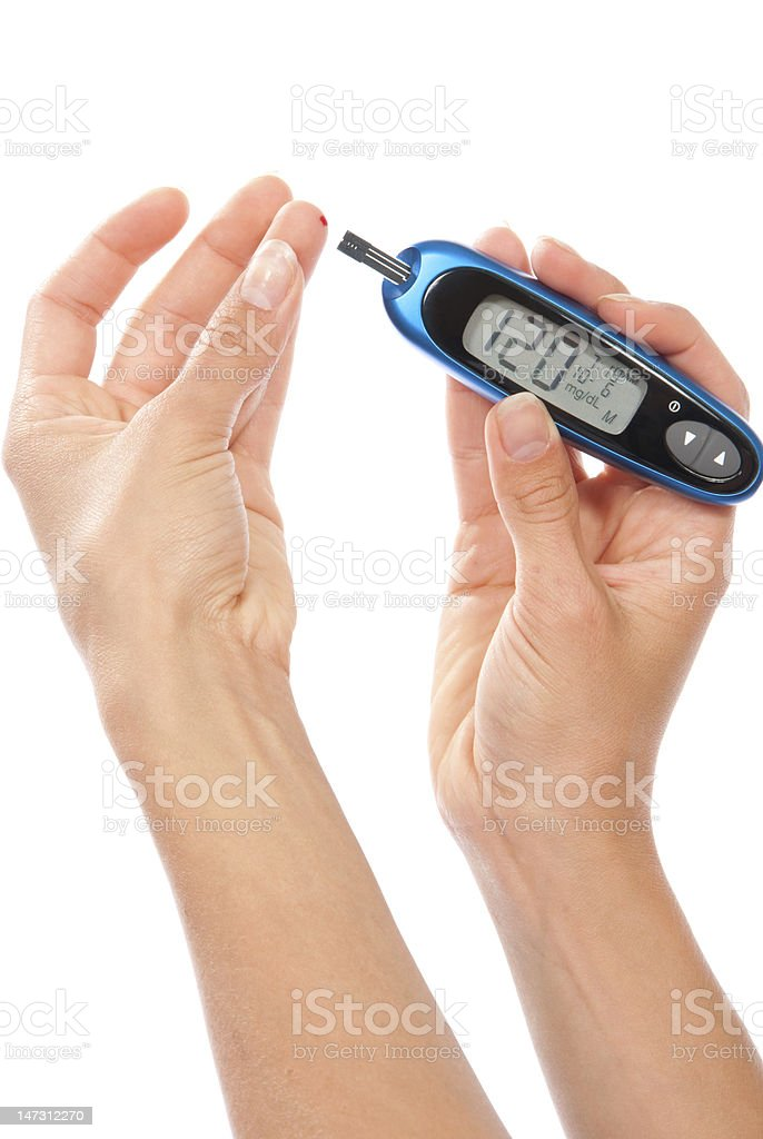 Diabetes patient measuring glucose level blood test royalty-free stock photo