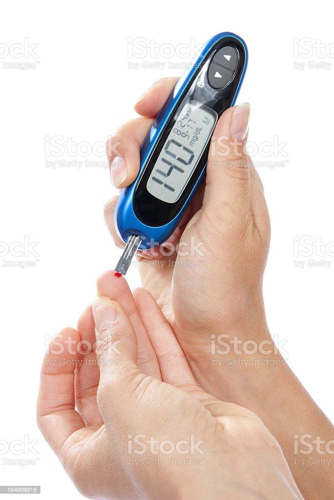 Diabetes patient measuring glucose level blood test stock photo