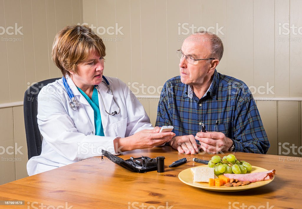 Diabetes patient receiving advice on glycemic index and blood sugar stock photo
