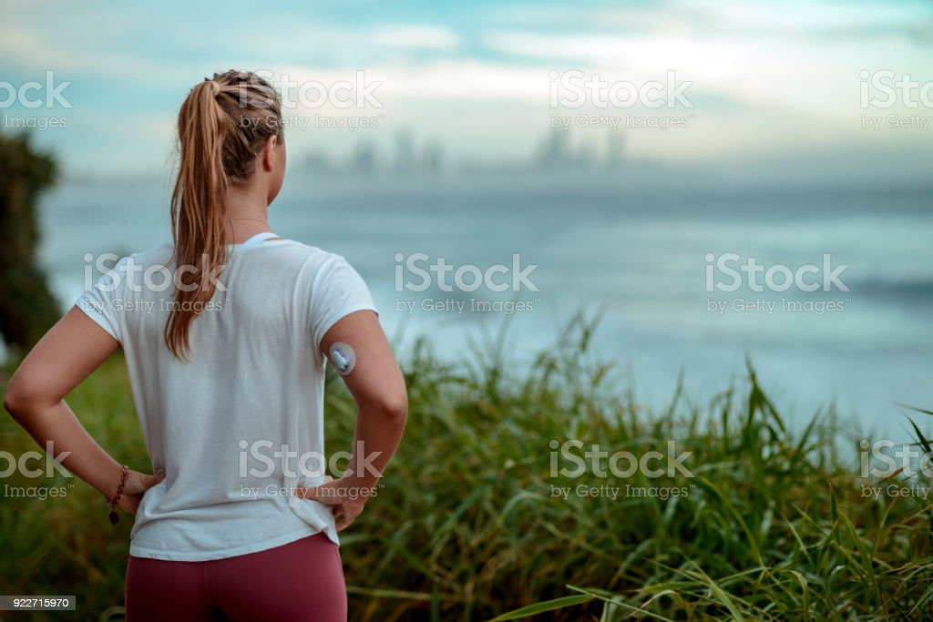 Diabetes woman ready for morning run along the coast stock photo