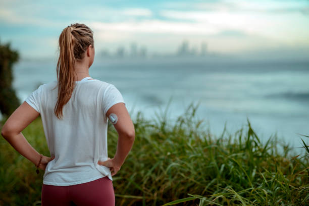 diabetes woman ready for morning run along the coast - diabetic stock photos and pictures