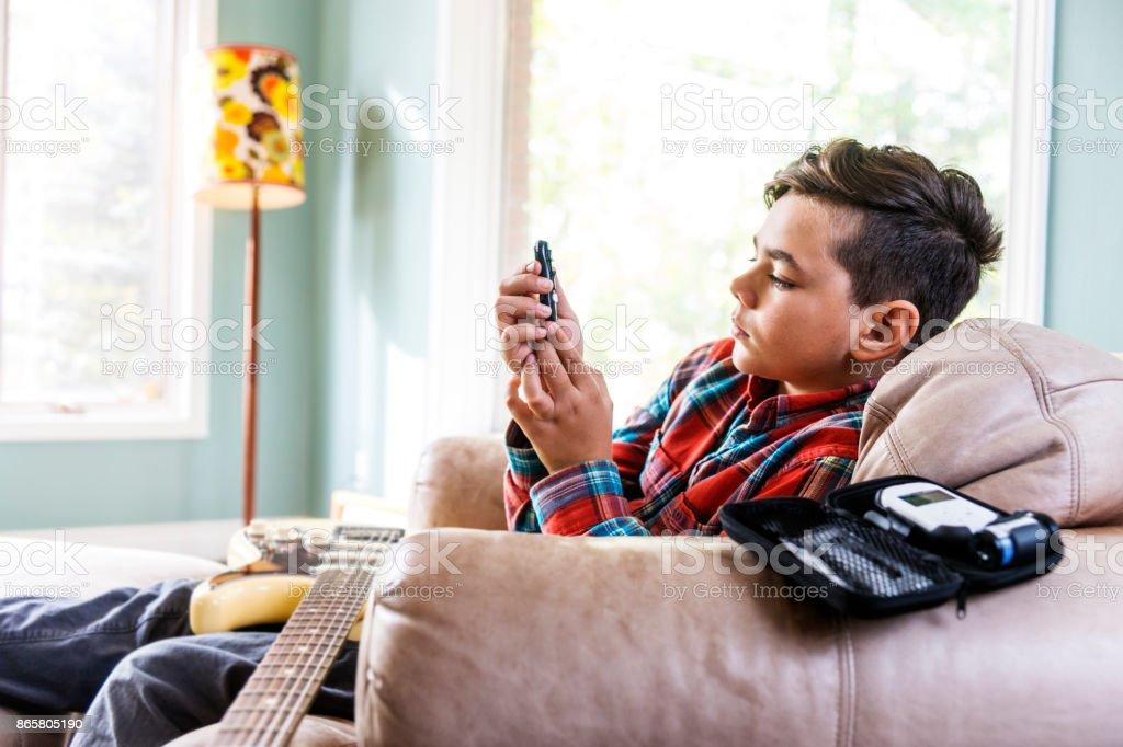 Diabetic child testing his blood sugar stock photo
