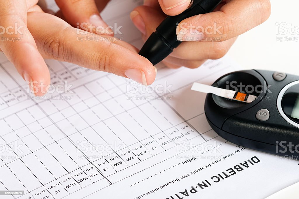 Diabetic drawing blood to test blood-sugar levels stock photo