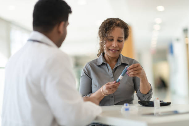 Diabetic patient meets with her doctor stock photo